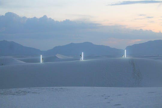 The video shoot combined director Peter Terezakis' light installations with the surreal vistas of the dunes.