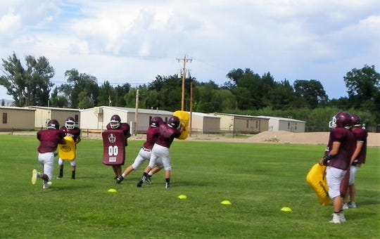 Members of the Tularosa High School Football Team practice drills at a practice Wednesday.