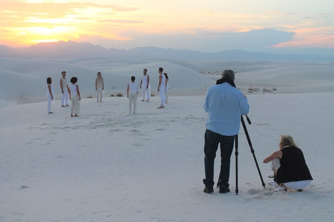 Director of photography Dennis Keeley and choreographer Allyson Green direct a group of dancers dancing in a music video for singer Chandrika Tandon on Wednesday.