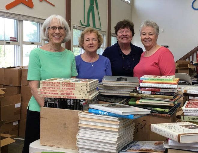 AAUW members Rose Zawinlak (from left), Sandy Spencer, Coco Siewert and Marty Harold work at sorting books for the September book sale. Money from the sale supports local scholarships and community projects.