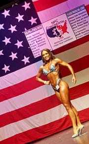 Displaying her chiseled and tanned physique during a recent bodybuilding competition is Redford Thurston alum Megan Schulz. She will participate Aug. 18 in the third NPC event of her two-year career.