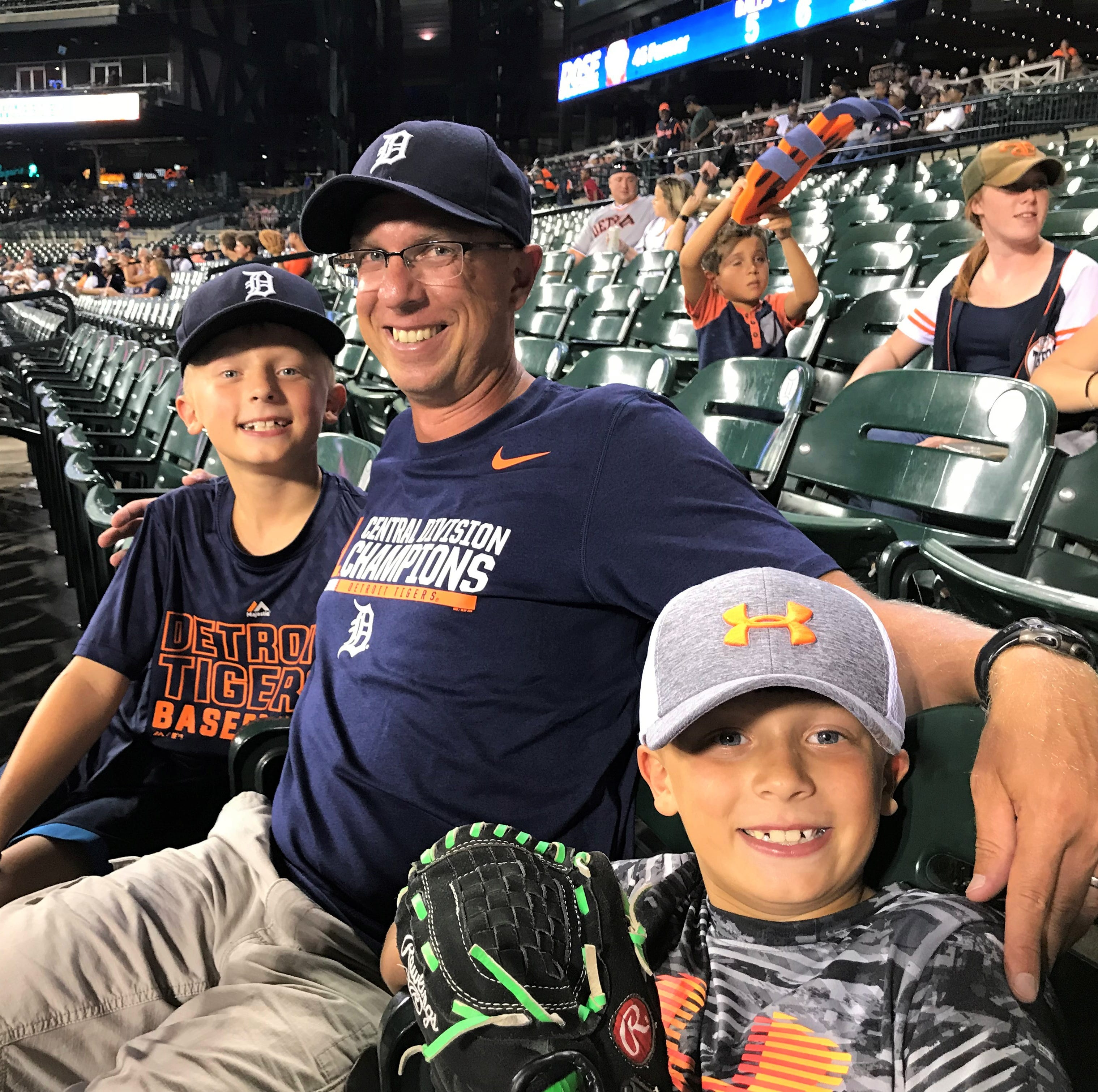 Franklin cross country coach Dave Bjorklund (middle), with his two sons Tyler (left) and Ryan (right), caught LaMarre's first Major League homer at Comerica Park.