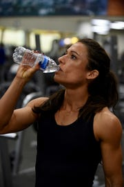 Staying hydrated is essential for Megan Schulz as she powers through her pre-competition regimen.