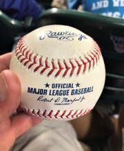 This is not the game ball for Ryan LaMarre's first Major League homer, but it was the next best thing given to Franklin teacher and coach Dave Bjorklund later in the game courtesy of the White Sox bullpen.