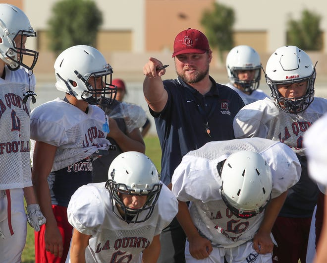 New La Quinta High School football coach Patrick Rivenes leads the team during practice, August 16, 2018.