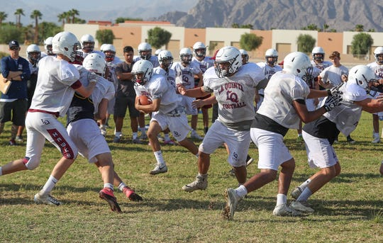 The La Quinta High School football team practices, August 16, 2018.