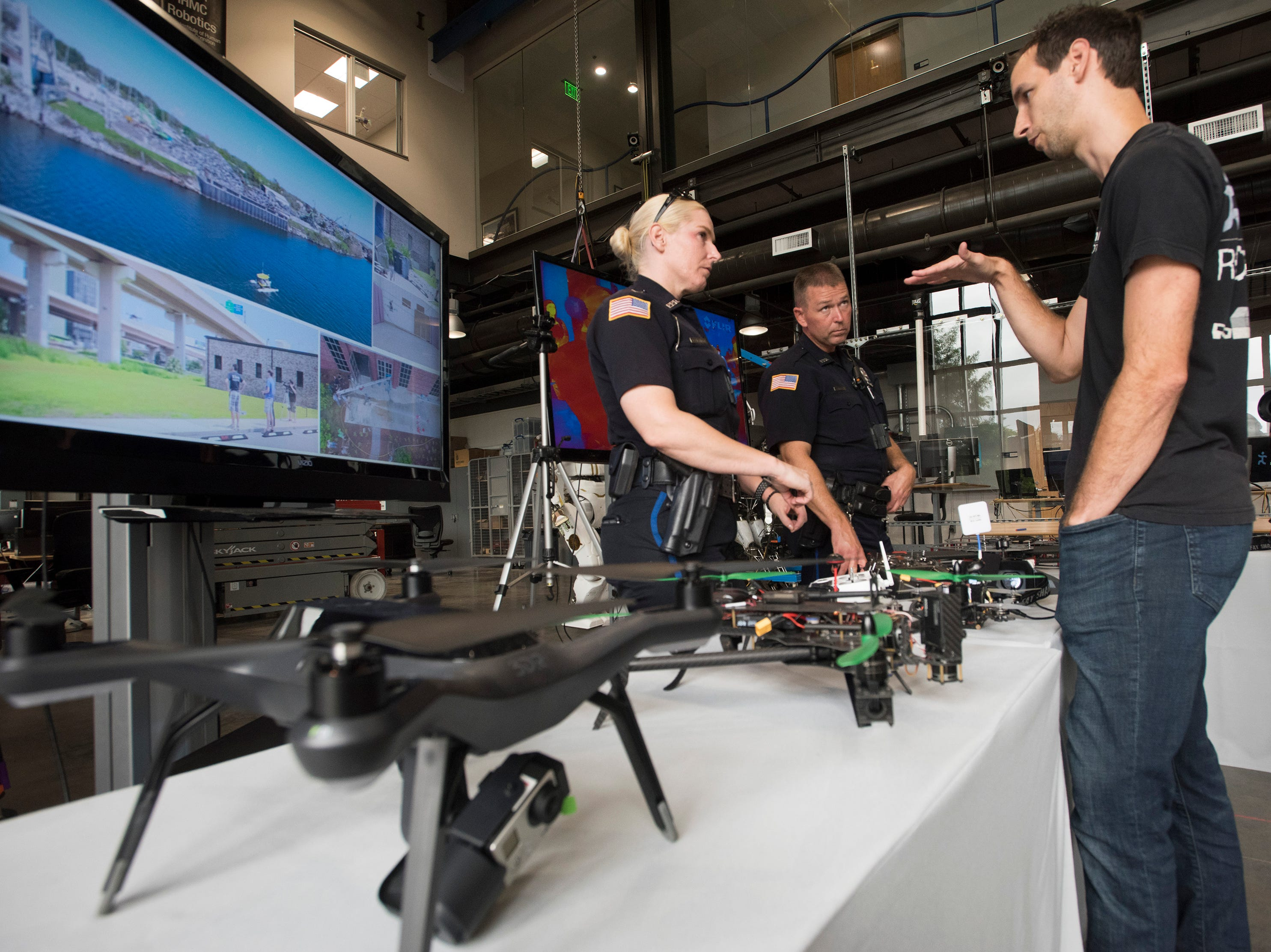 Institute of Human and Machine Cognition, Research Assoc. John Carff describes the drone technology available on the open market to Pensacola Police Officers, Kelly Eierhart, and Robert Lindblow during a tour of the IHMC facilities on Thursday, Aug. 16, 2018. The PPD and IHMC are working together on a plan to implement the new technology into its law enforcement capabilities.