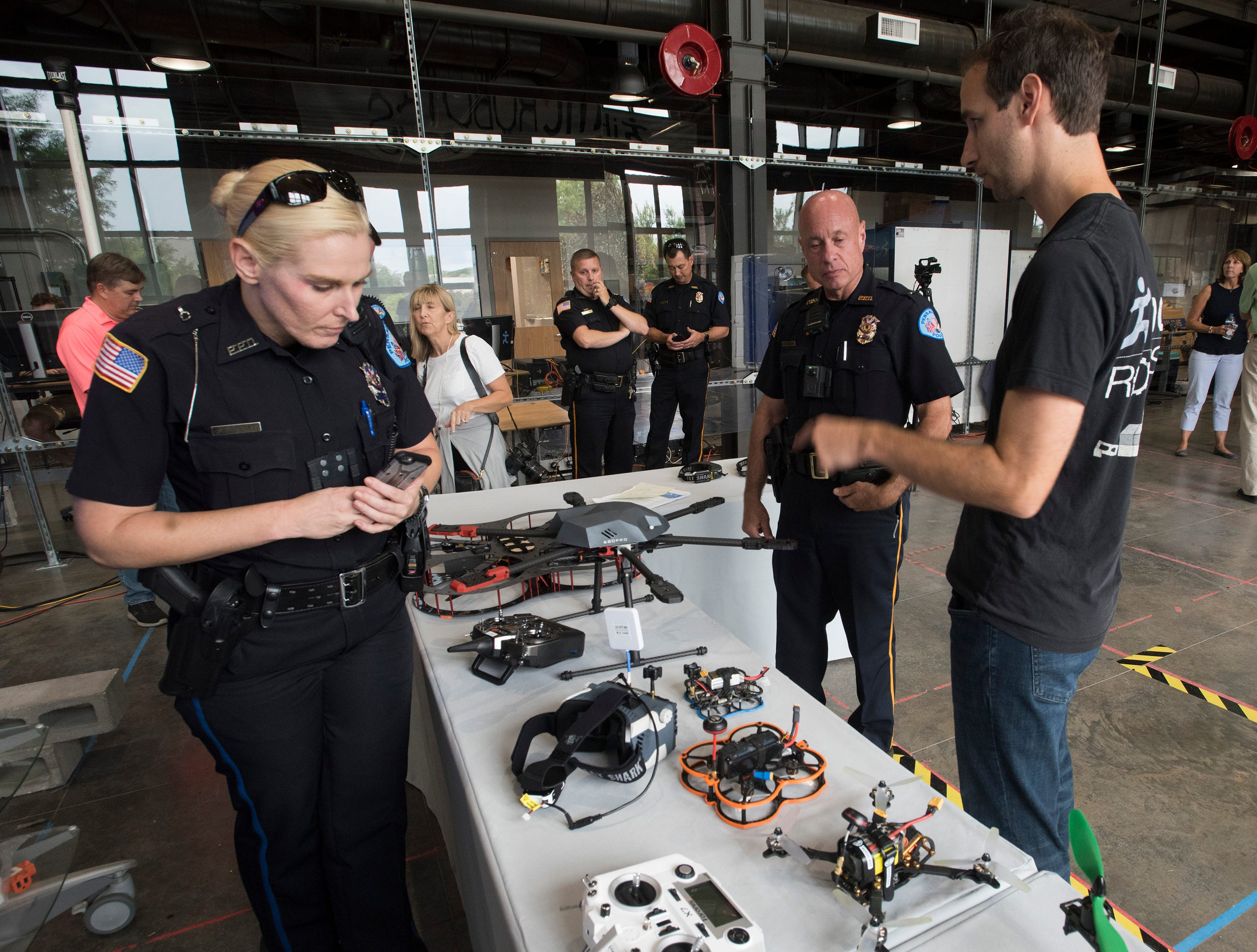Institute of Human and Machine Cognition, Research Assoc. John Carff describes the drone technology available on the open market to Pensacola Police Officers, Kelly Eierhart, and Steve Bauer during a tour of the IHMC facilities on Thursday, Aug. 16, 2018. The PPD and IHMC are working together on a plan to implement the new technology into its law enforcement capabilities.