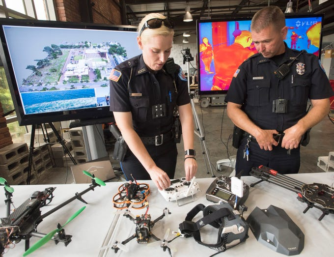 Pensacola Police Officers, Kelly Eierhart, and Robert Lindblom study at the done technology on display at the Institute of Human and Machine Cognition, on Thursday, Aug. 16, 2018. The PPD and IHMC are working together on a plan to implement the technology into its law enforcement capabilities.