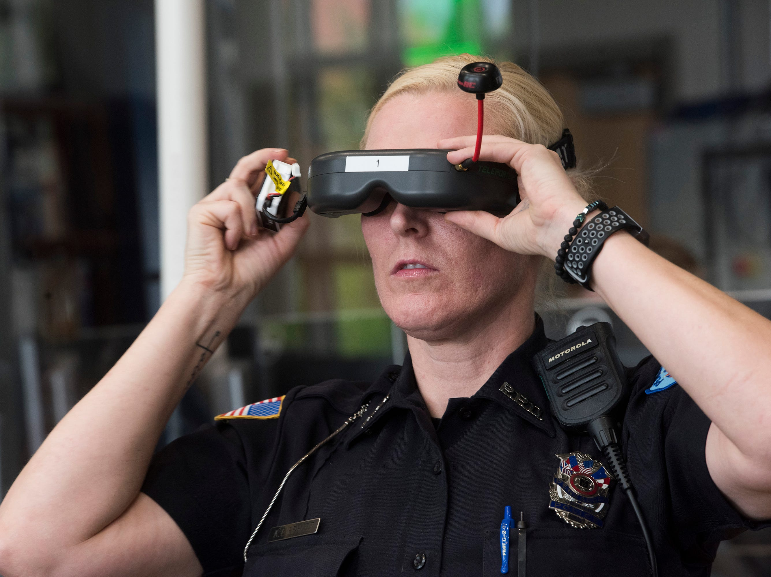 Pensacola Police Officer, Kelly Eierhart, marvels at seeing a real-time flight demonstration from a drone at the Institute of Human and Machine Cognition on Thursday, Aug. 16, 2018.