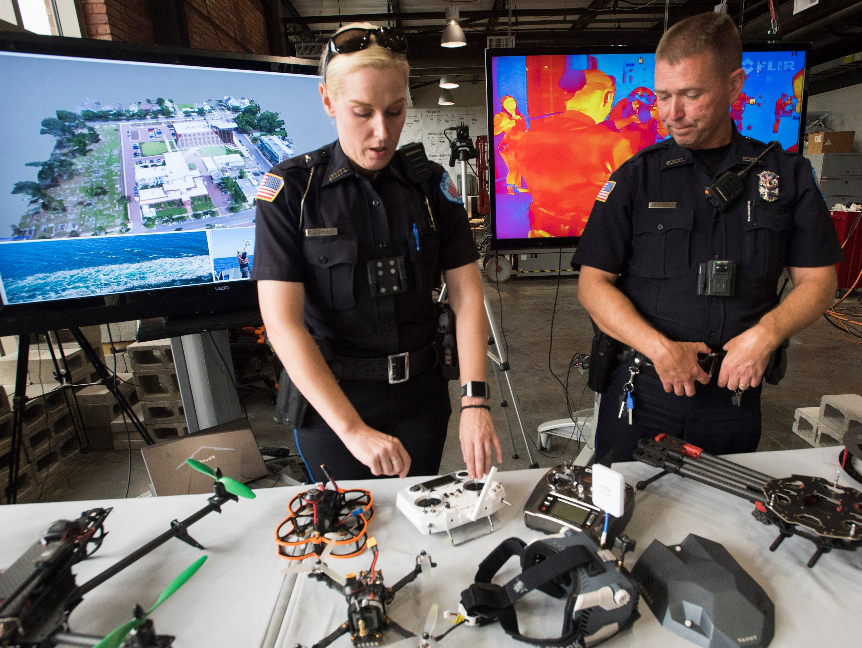 Pensacola Police Officers Kelly Eierhart and Robert Lindblom talk about the drone technology on display at the Institute of Human and Machine Cognition on Thursday, Aug. 16, 2018. PPD and IHMC are working together on a plan to use drones to help law enforcement.