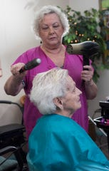 Diana Montgomery cuts and styles hair for Donna Ganley at her shop Styles By Diana in Warrington on Thursday, Aug. 16, 2018. Ganley has been a getting her hair done by Montgomery for more than 50-years.