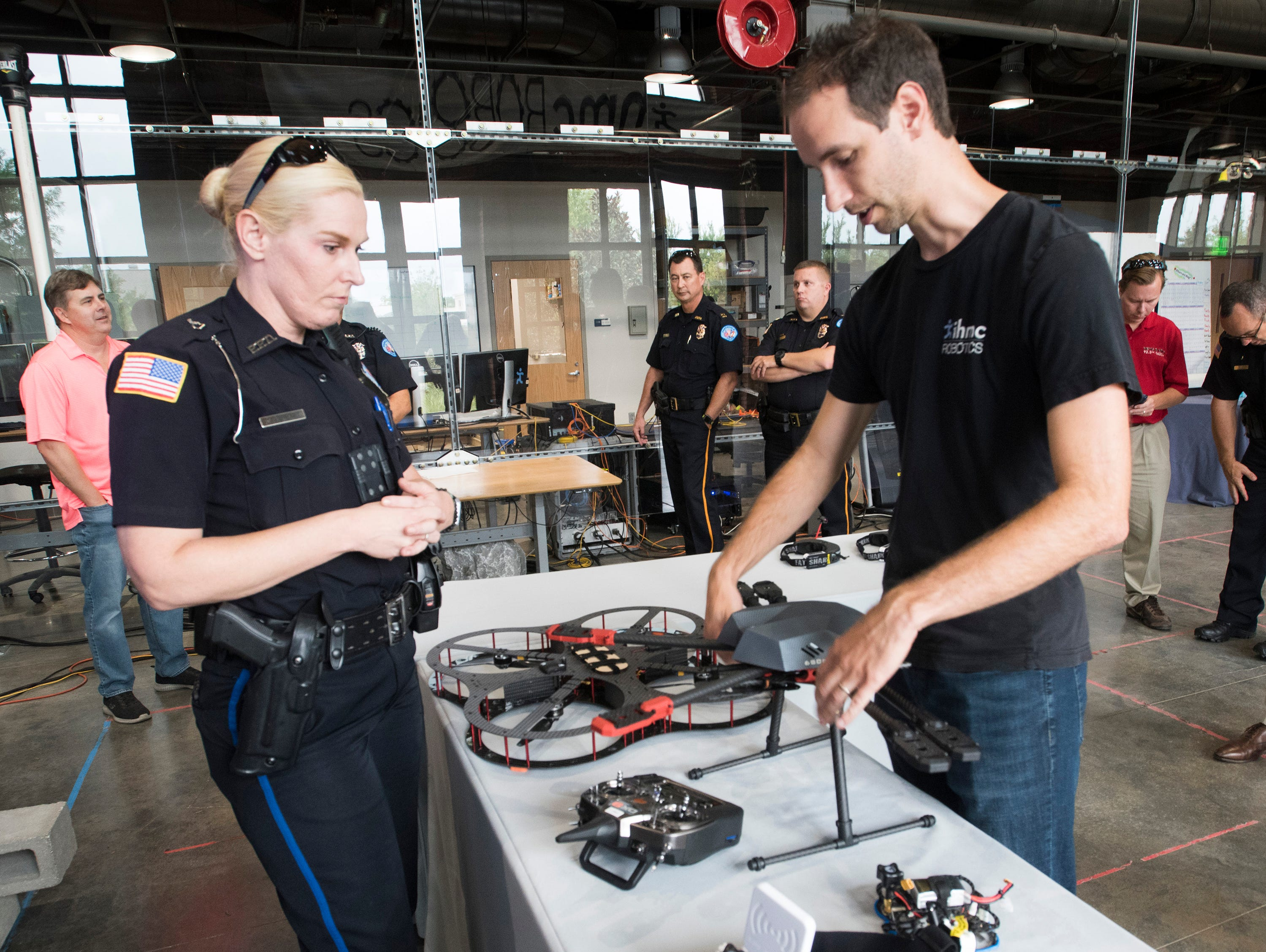 Institute of Human and Machine Cognition, Research Assoc. John Carff describes the drone technology available on the open market to Pensacola Police Officers, Kelly Eierhart, during a tour of the IHMC facilities on Thursday, Aug. 16, 2018. The PPD and IHMC are working together on a plan to implement the new technology into its law enforcement capabilities.