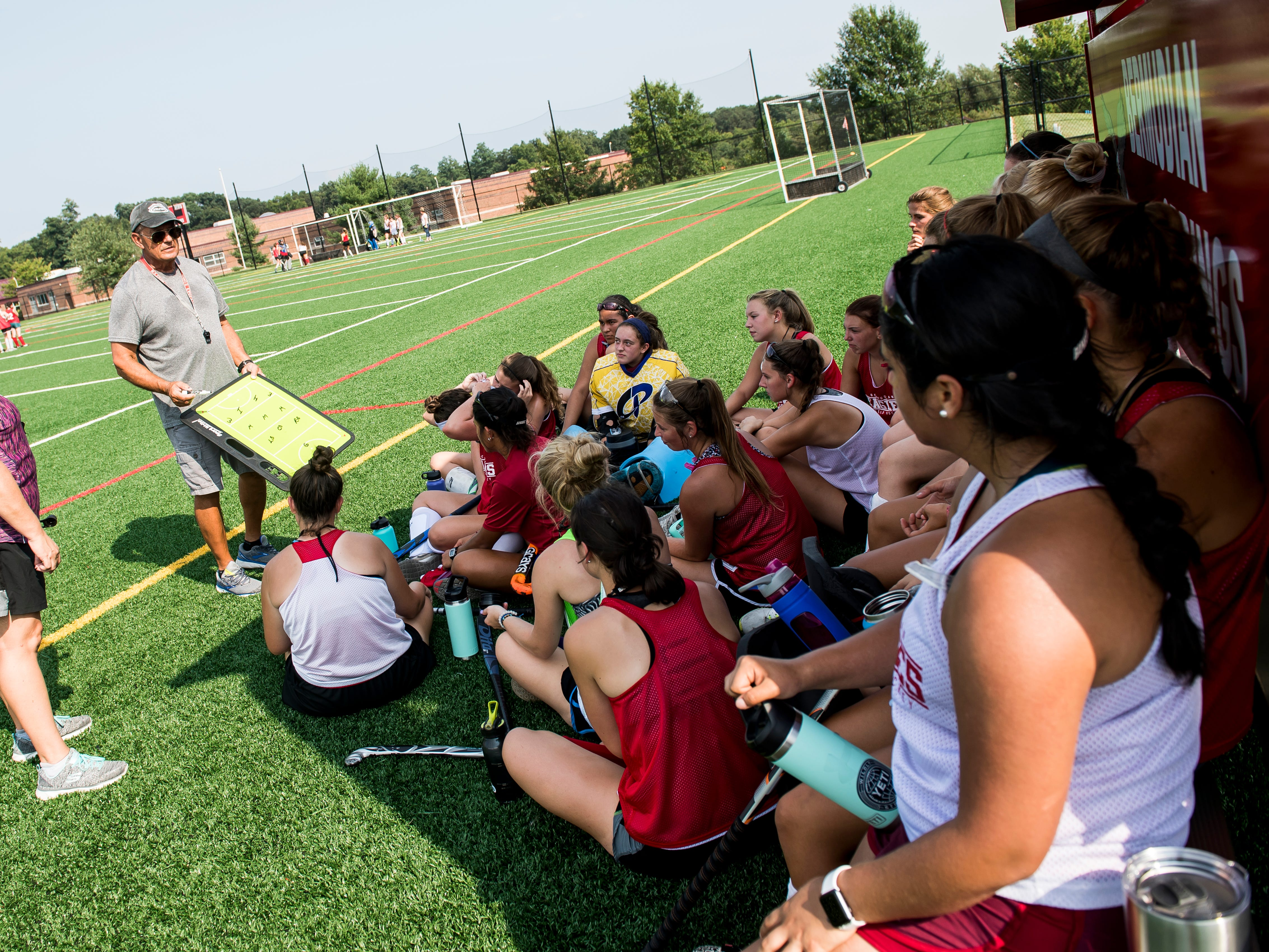 Bermudian Springs field hockey players listen to head coach Neil Bixler during practice on Thursday, August 16, 2018.
