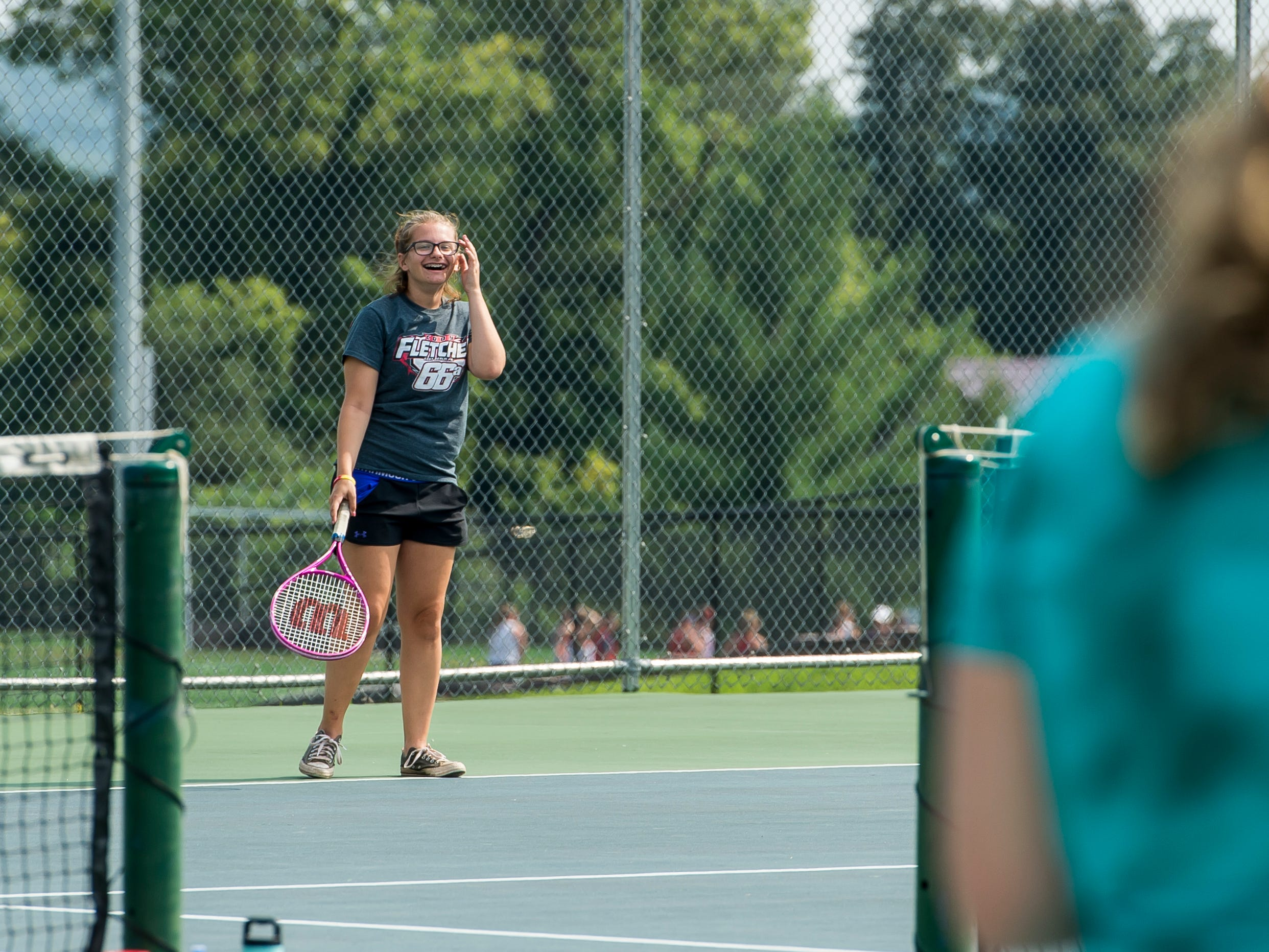 Olivia Snelbaker laughs after accidentally hitting a ball into another court during Bermudian Springs girls tennis practice on Thursday, August 16, 2018.