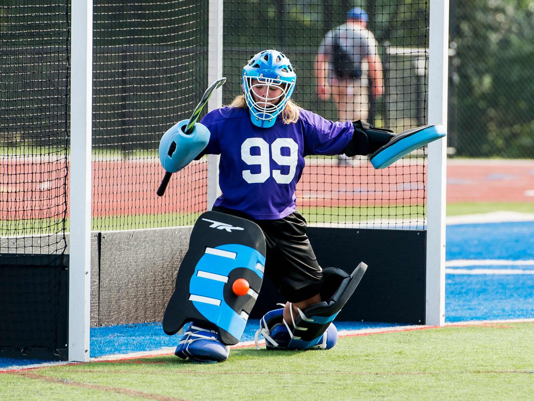 A Spring Grove field hockey goalkeeper blocks a shot during practice on Wednesday, August 15, 2018.
