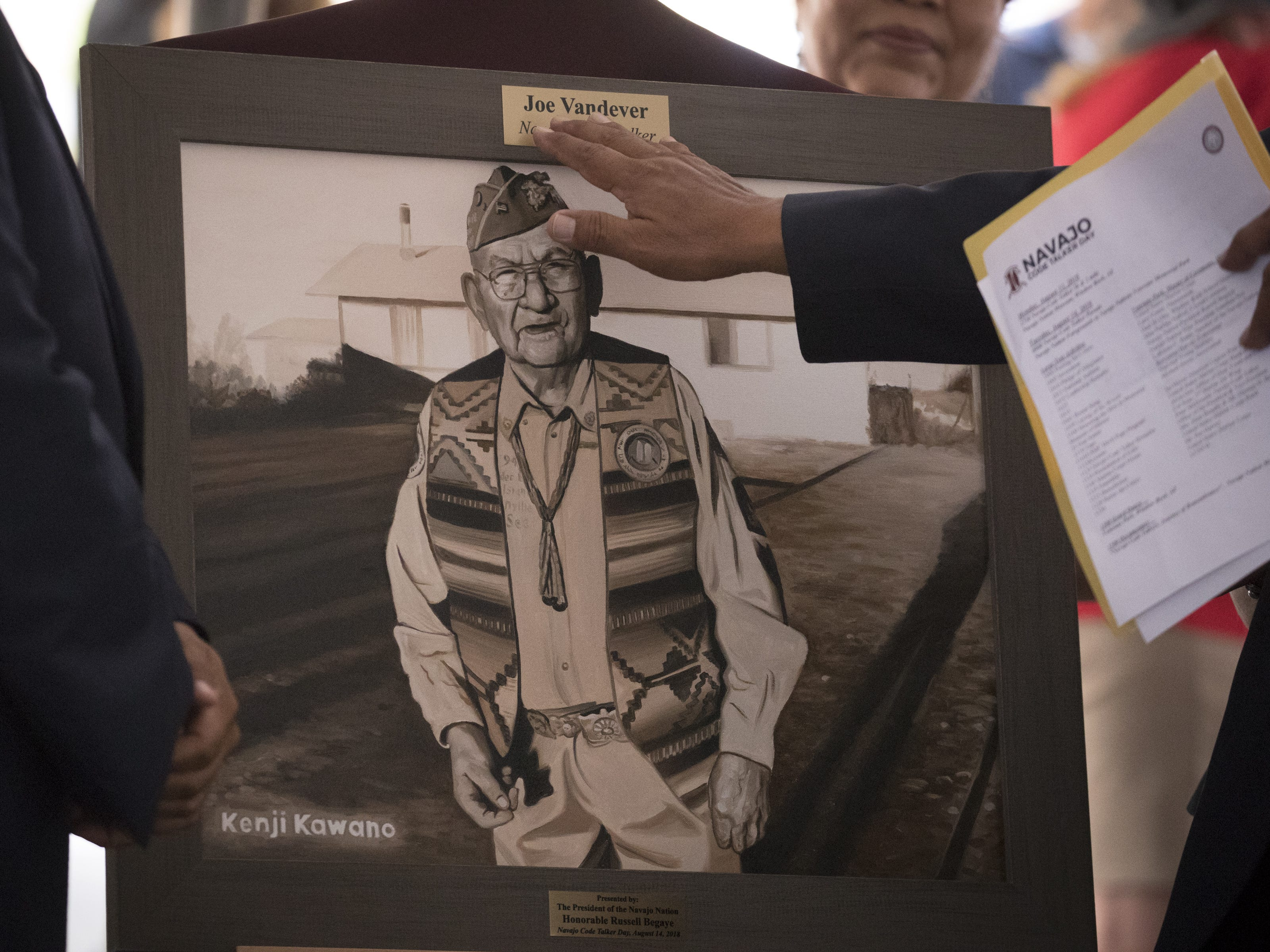 A portrait of Navajo Code Talker Joe Vandever, Sr. is unveiled during the Navajo Nation Code Talkers Day ceremony on Aug. 14, 2018, at the Veterans Memorial Park in Window Rock.