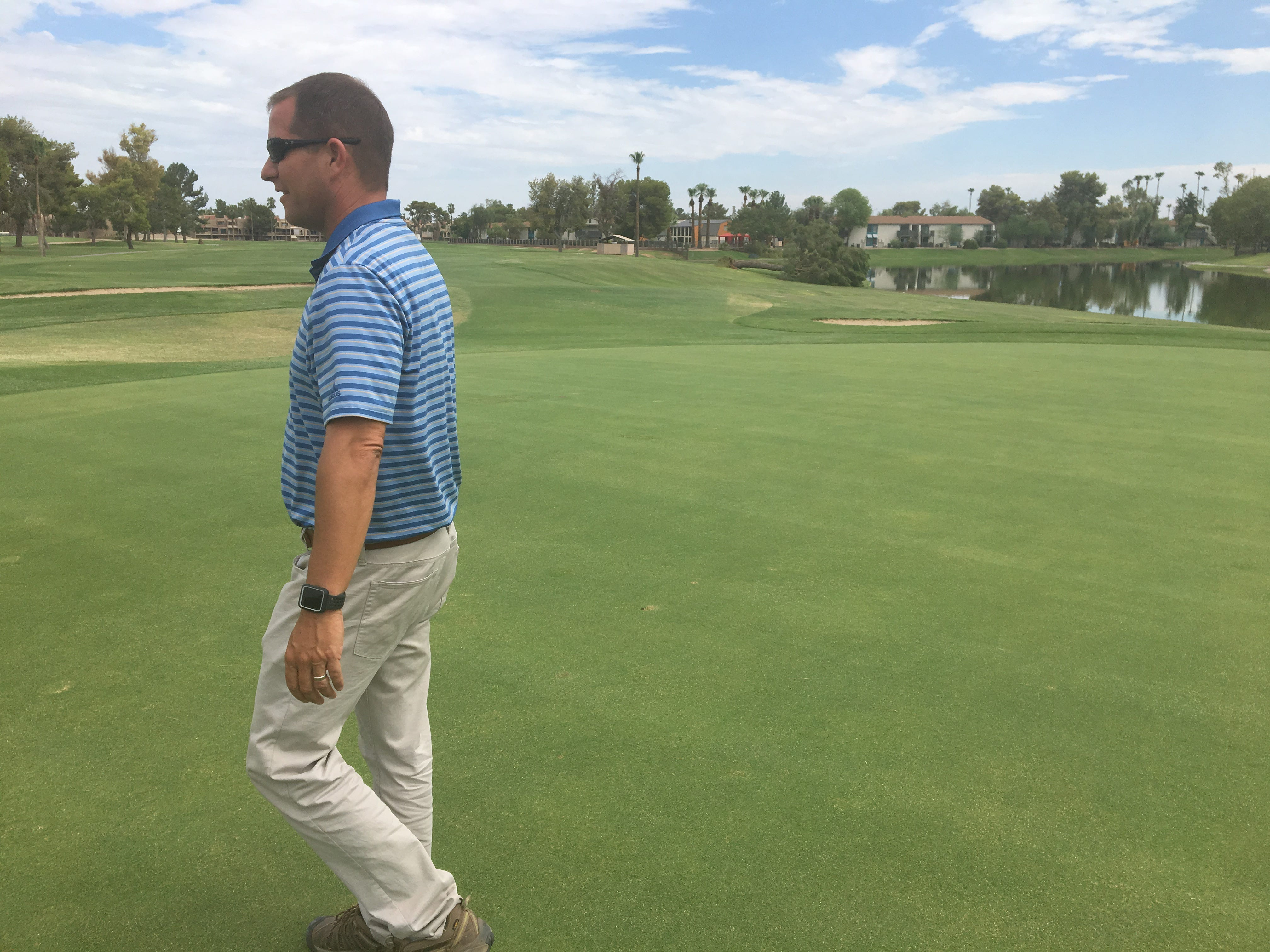 Erik Ostlund surveys storm damage at Dobson Ranch Golf Course. The city-run course lost 57 trees in one week during August 2018.