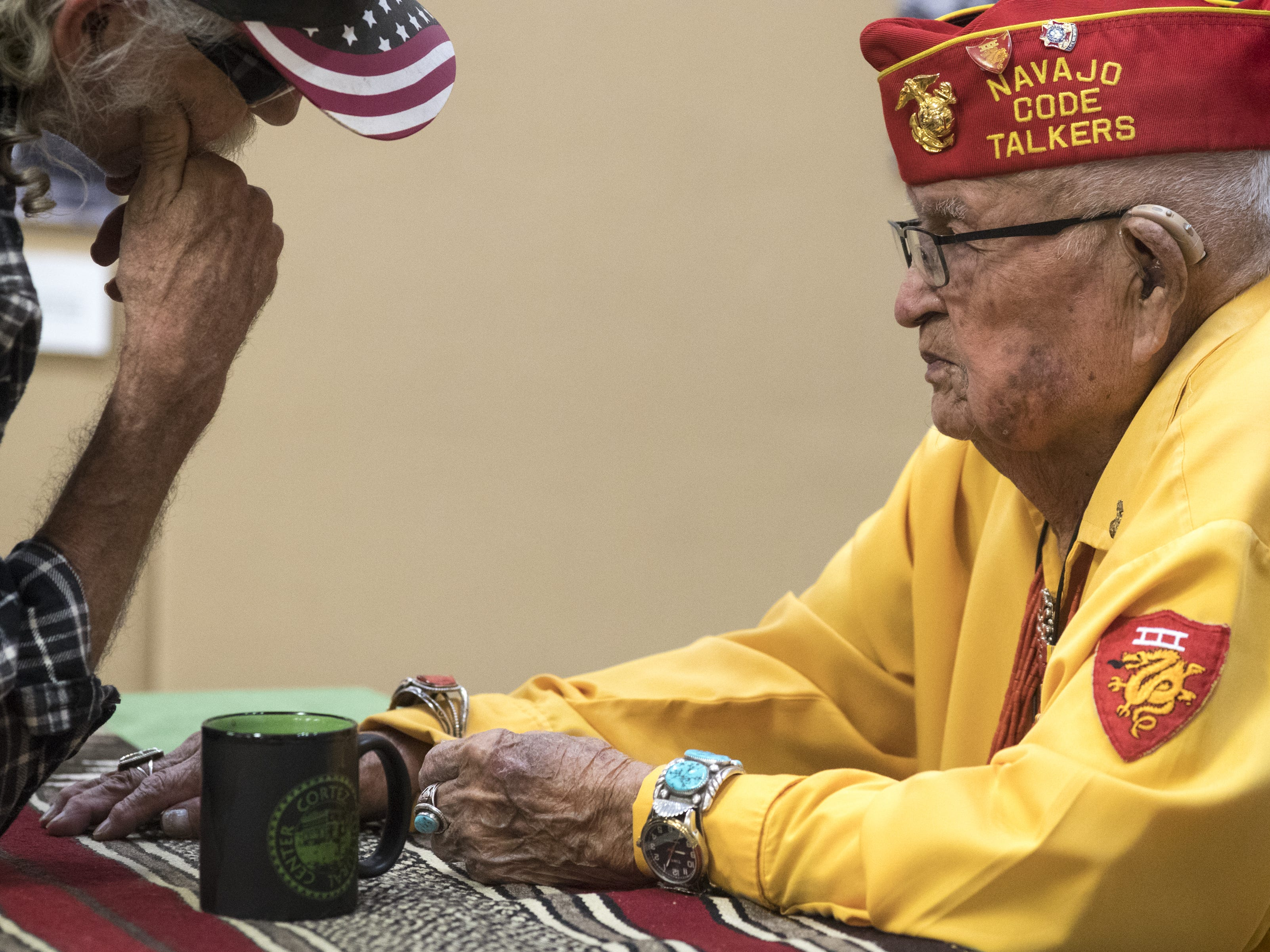Navajo Code Talker Sam Sandoval is greeted by a guest on Aug. 14, 2018, after speaking at the Cortez Cultural Center in Cortez, Colorado.