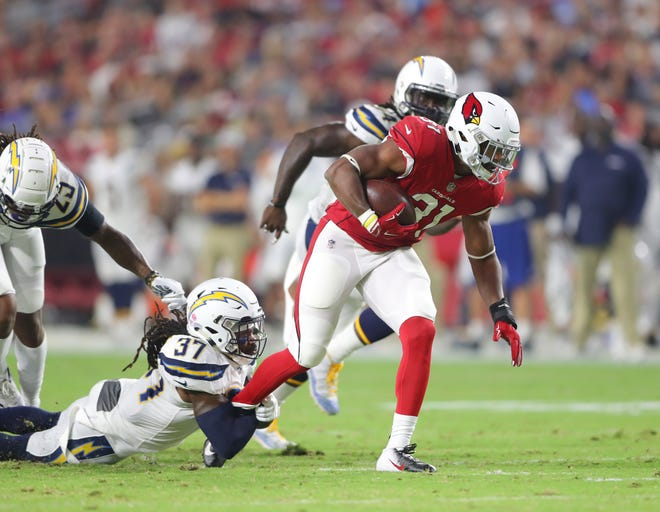 Arizona Cardinals running back David Johnson (31) is tackled by Los Angeles Chargers safety Jahleel Addae (37) during a preseason game at University of Phoenix Stadium.