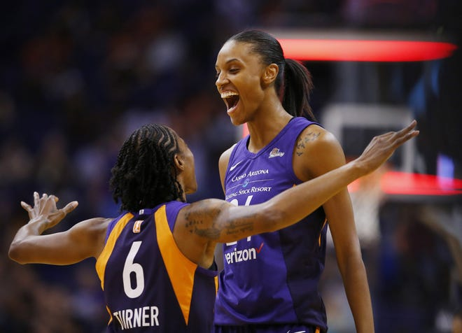 Mercury forward DeWanna Bonner, right, celebrates with Yvonne Turner after hitting 40-footer to end the third quarter on Sunday against the Los Angeles Sparks at Talking Stick Resort Arena in Phoenix.
