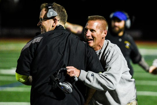Northern Lebanon head coach Roy Wall celebrates with assistant coach Chris George as Northern Lebanon held off Lancaster Catholic 21-14 to win the Section 3 title at Lancaster Catholic on Friday, Nov. 3, 2017.
