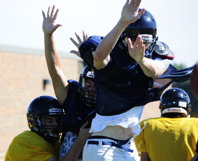 Trevor Boers, a senior wideout and linebacker for Capac High School, tries to block a kick during football practice
