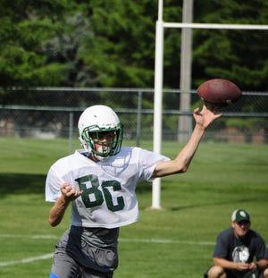 Junior quarterback Matt Daws throws a pass during a Brown City High School football practice.