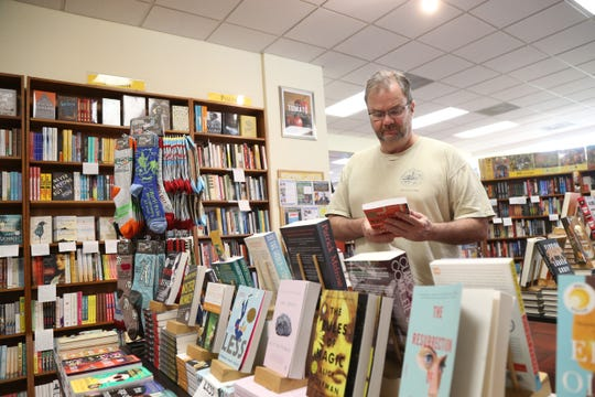 Jim Grabeel of Woodstock browses some fiction at Oblong Books & Music in Rhinebeck on August 16 2018.