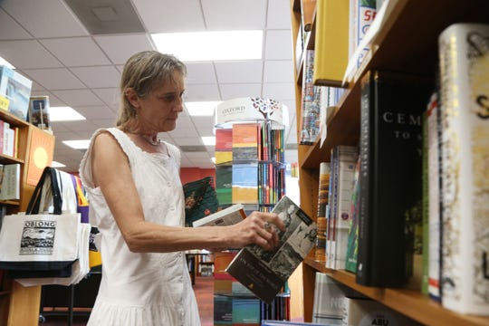 Shana Cutler of Saugerties browses some the travel section at Oblong Books & Music in Rhinebeck on August 16 2018.