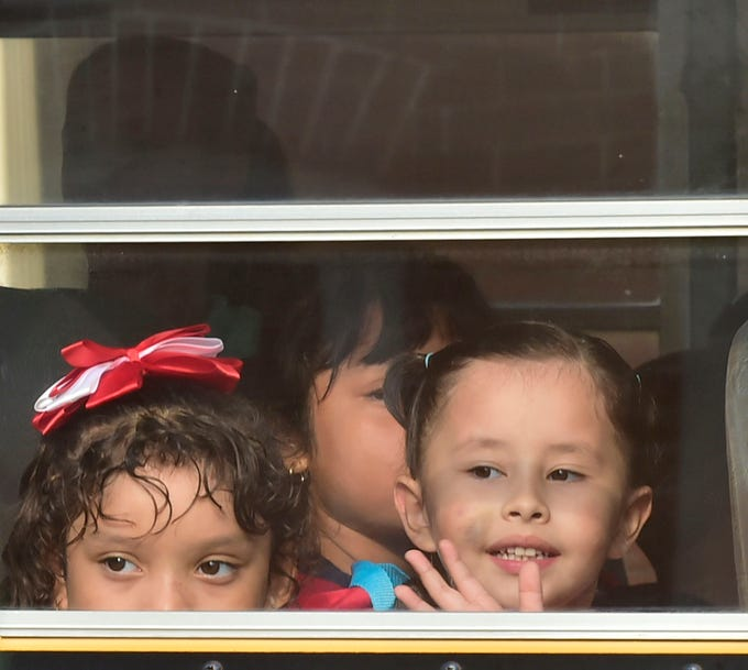 Noemi Alejandra de la Cruz Lemus, right, waves at her mother as she leaves for school. Students headed off to their first day of classes in the Chambersburg Area School District on Thursday, August 16, 2018.