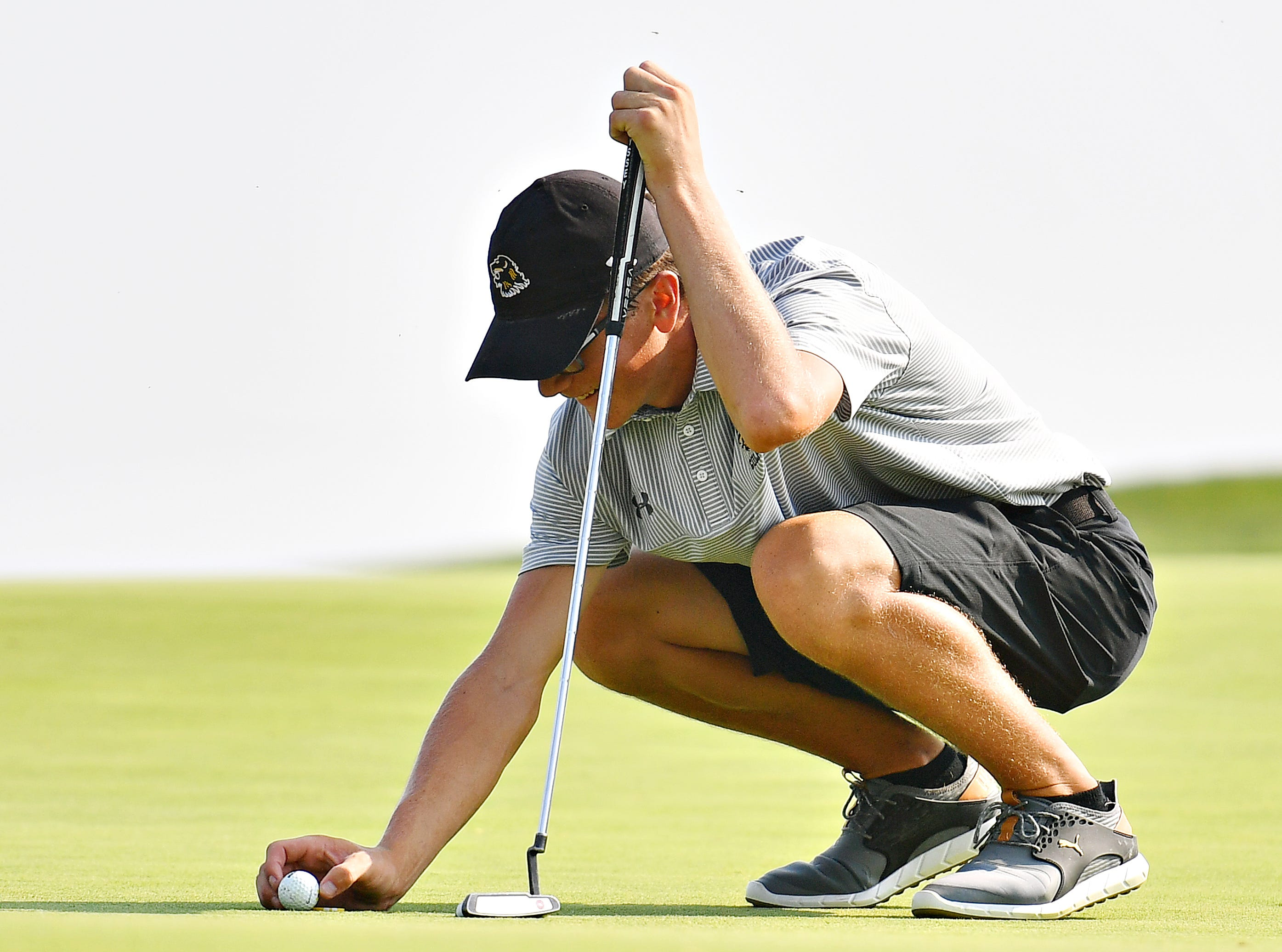Red Lion's Channing Bratton lines up his shot on the green at hole three during York-Adams League Division I golf action at Royal Manchester Golf Links in East Manchester Township, Thursday, Aug. 16, 2018. Dawn J. Sagert
