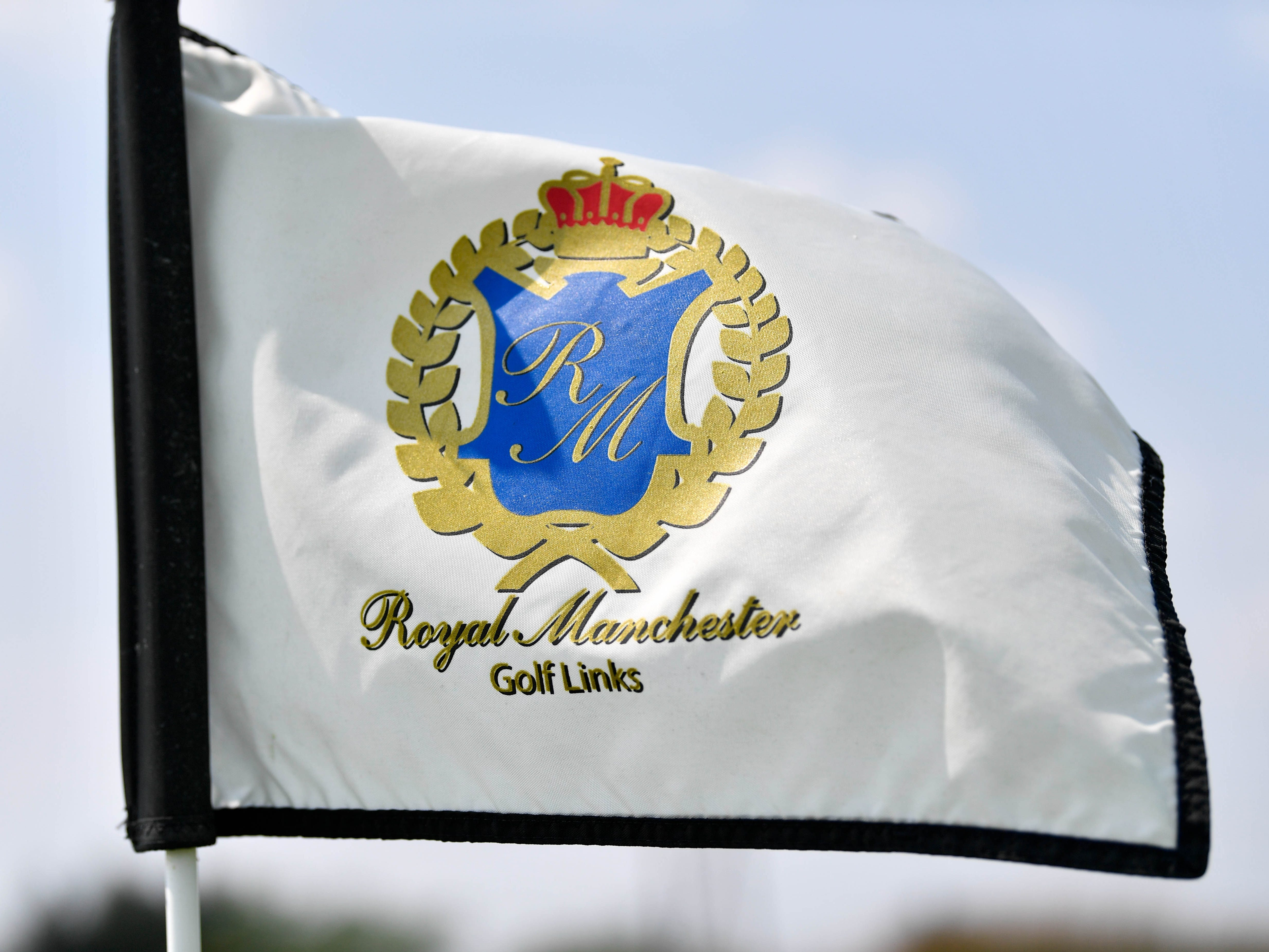 Royal Manchester Golf Links' flags gently wave in the wind as Division I golfers compete on Wednesday, Aug. 16, 2018.