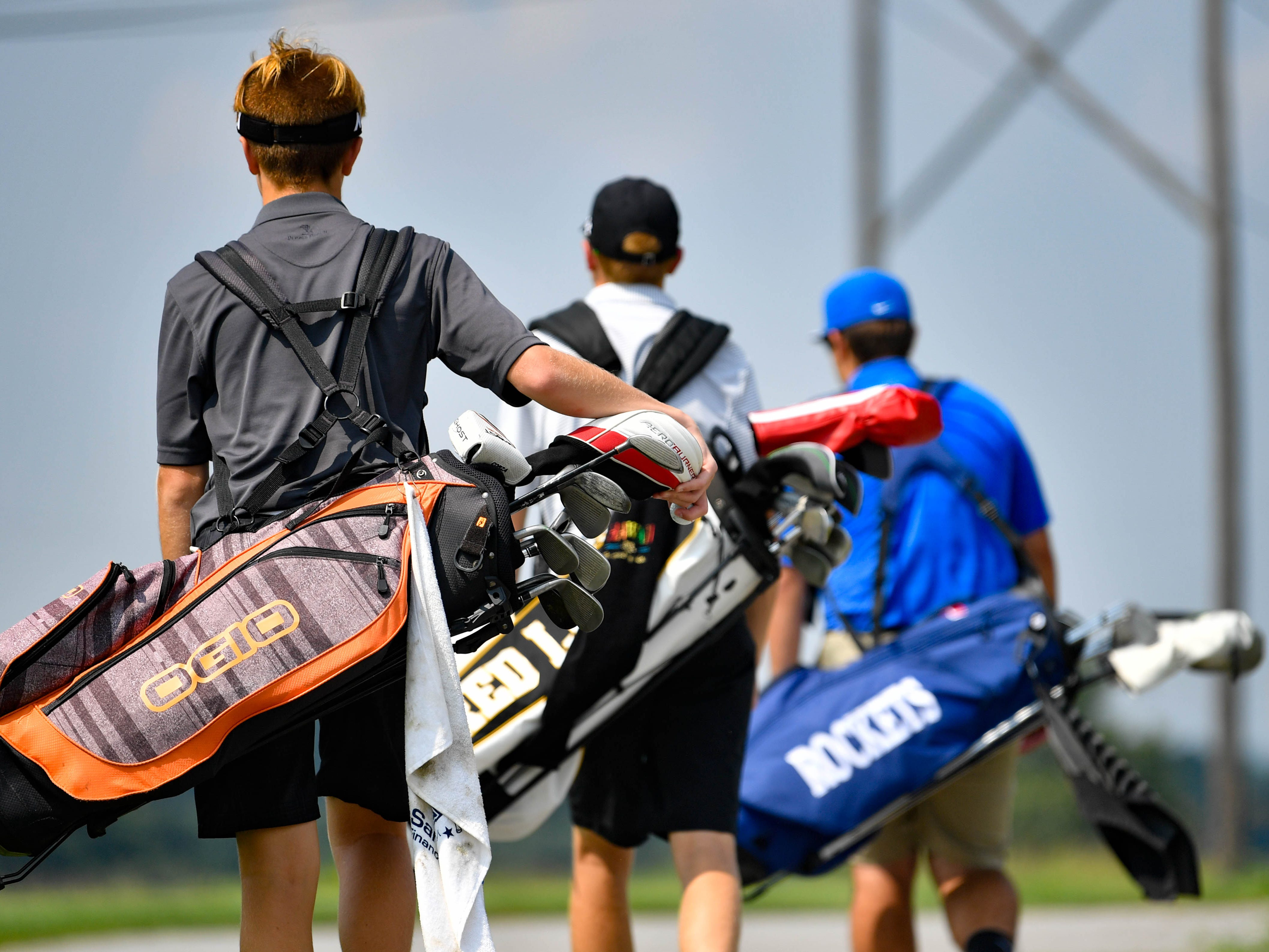 Dallastown, Spring Grove and Red Lion golfers journey to their next hole during a Division I golf match at Royal Manchester Golf Links, Wednesday, Aug. 16, 2018.