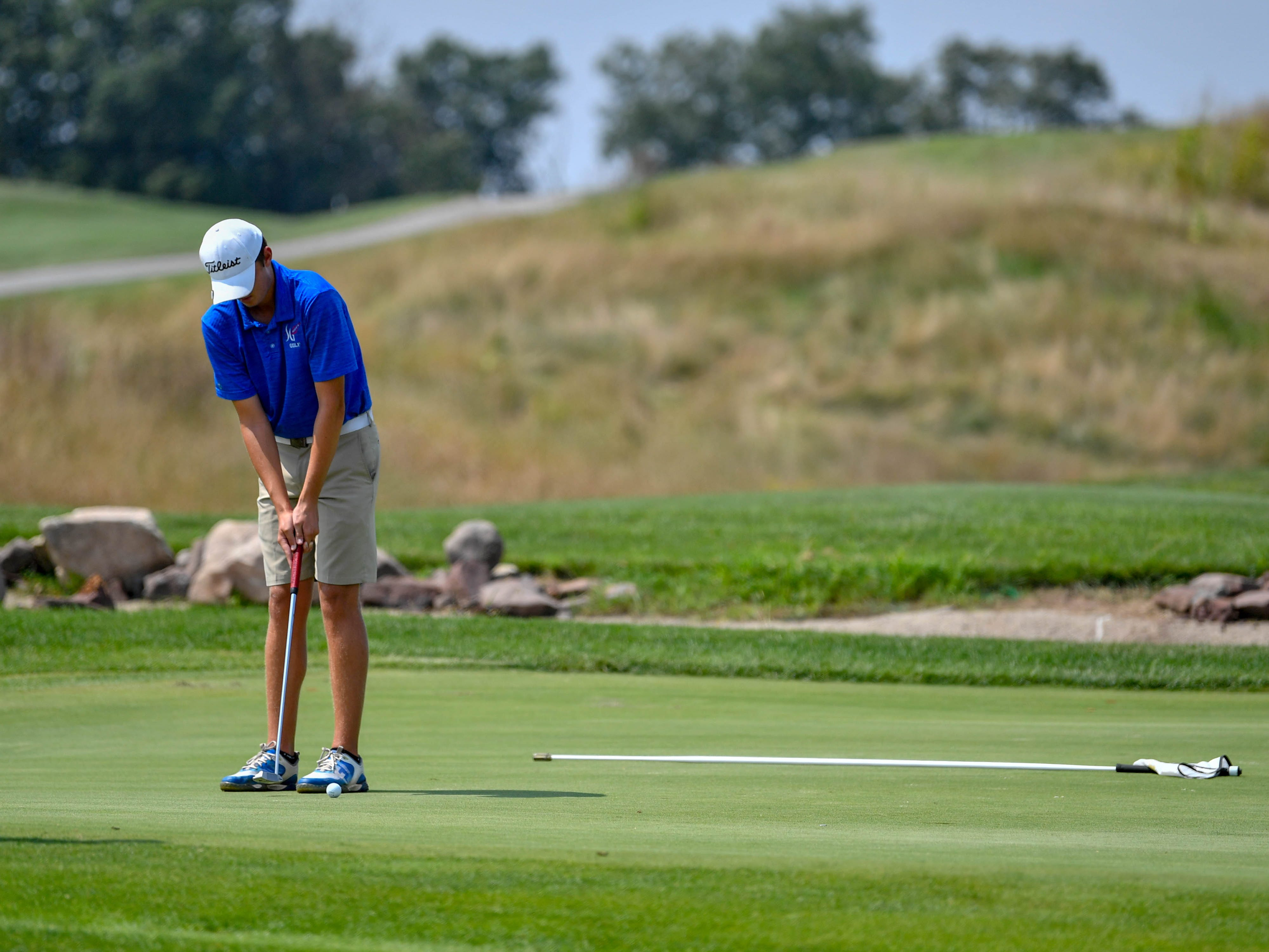 Spring Grove's Brandon Simmons lines up the putt during a Division I golf match at Royal Manchester Golf Links, Wednesday, Aug. 16, 2018.