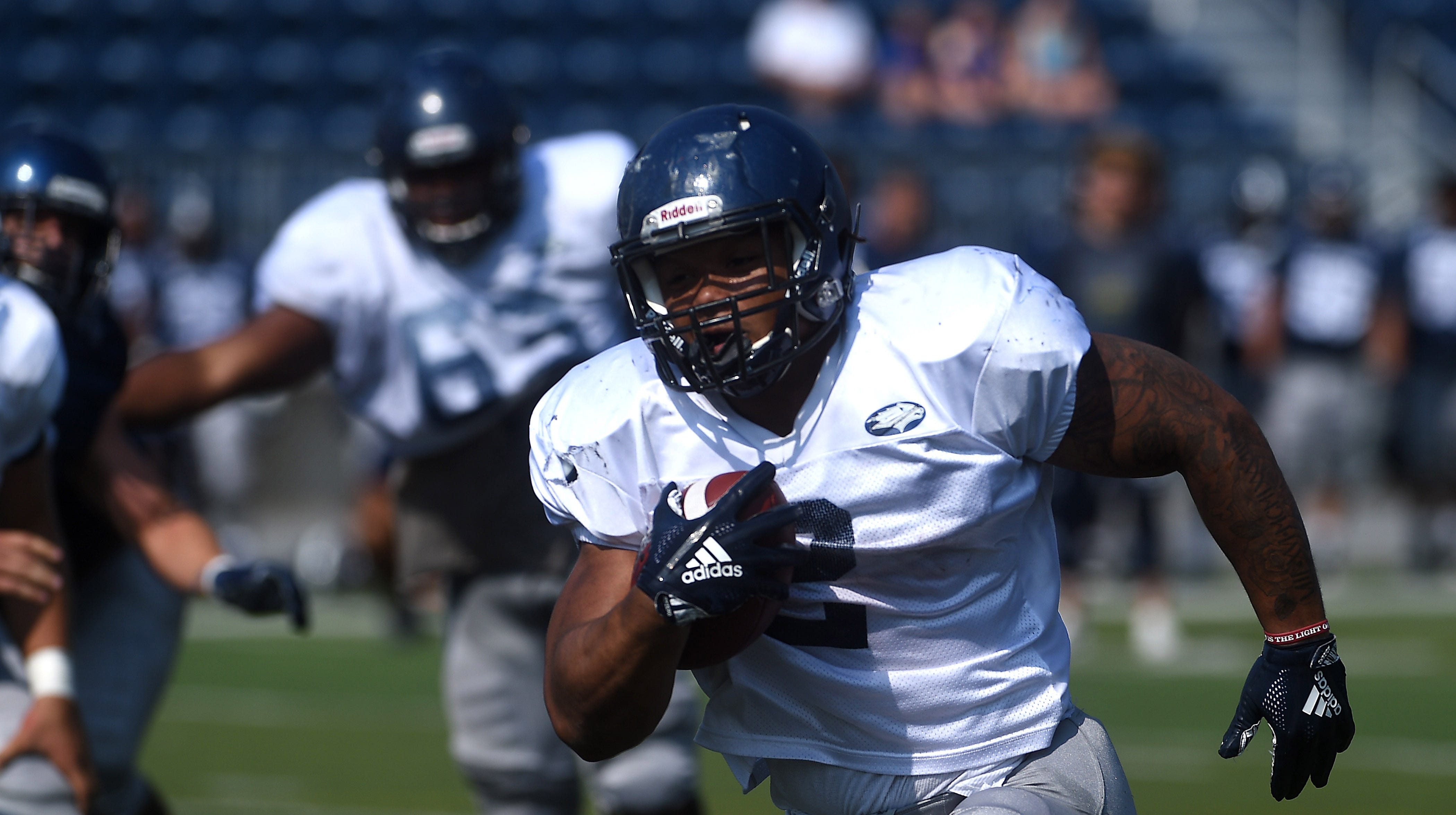 Running back Devonte Lee breaks free for a big gain during Nevada football's scrimmage Saturday at Mackay Stadium.
