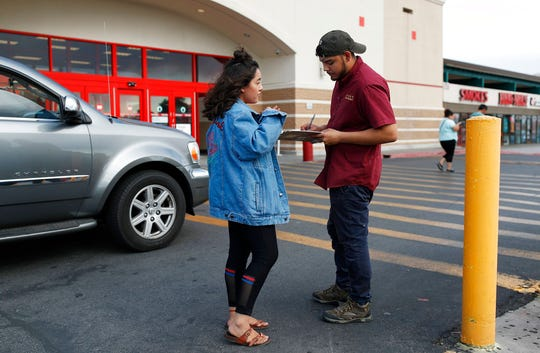 Jazmin Cortez, left, registers Victor Arias to vote Aug. 15, 2018 in Las Vegas. Democrats in Nevada are working to register and engage Latino voters ahead of this year's midterms, hoping to recreate the big wins that the state's Hispanic and immigrant community are credited with delivering two years ago.