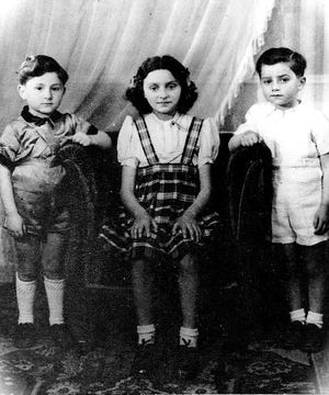 A photo of Leon Malmed (right), Rachel Epstein and their cousin, Charles, taken in 1942.