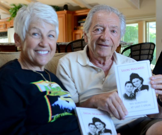 "Leon Malmed, 80, (right) and his wife, Patricia, hold a copy of Malmed's book, ""We Survived... At Last I Speak."" The photo was taken June 29, 2018 at their South Lake Tahoe home."