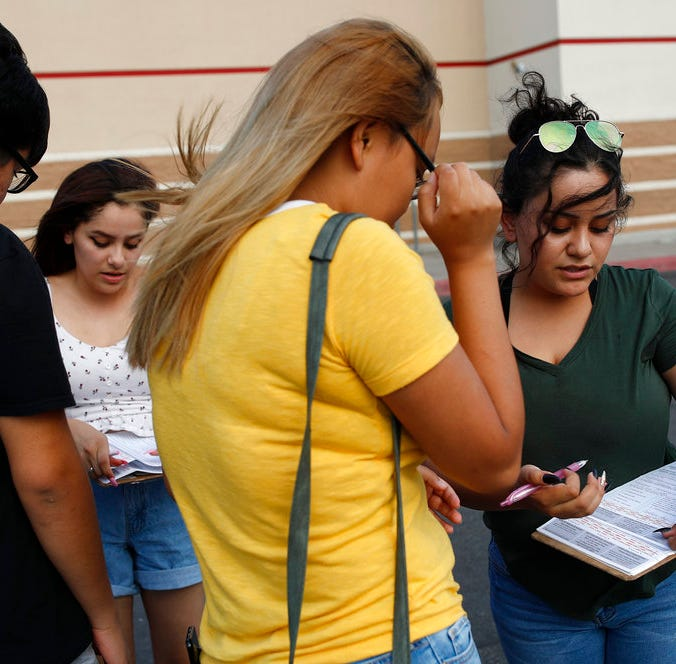 Maria Nieto, right, and Alma Romo, second from left, register people to vote in Las Vegas on Aug. 15, 2018. Democrats in Nevada are working to register and engage Latino voters ahead of this year's midterms, hoping to recreate the big wins that the state's Hispanic and immigrant community are credited with delivering two years ago.