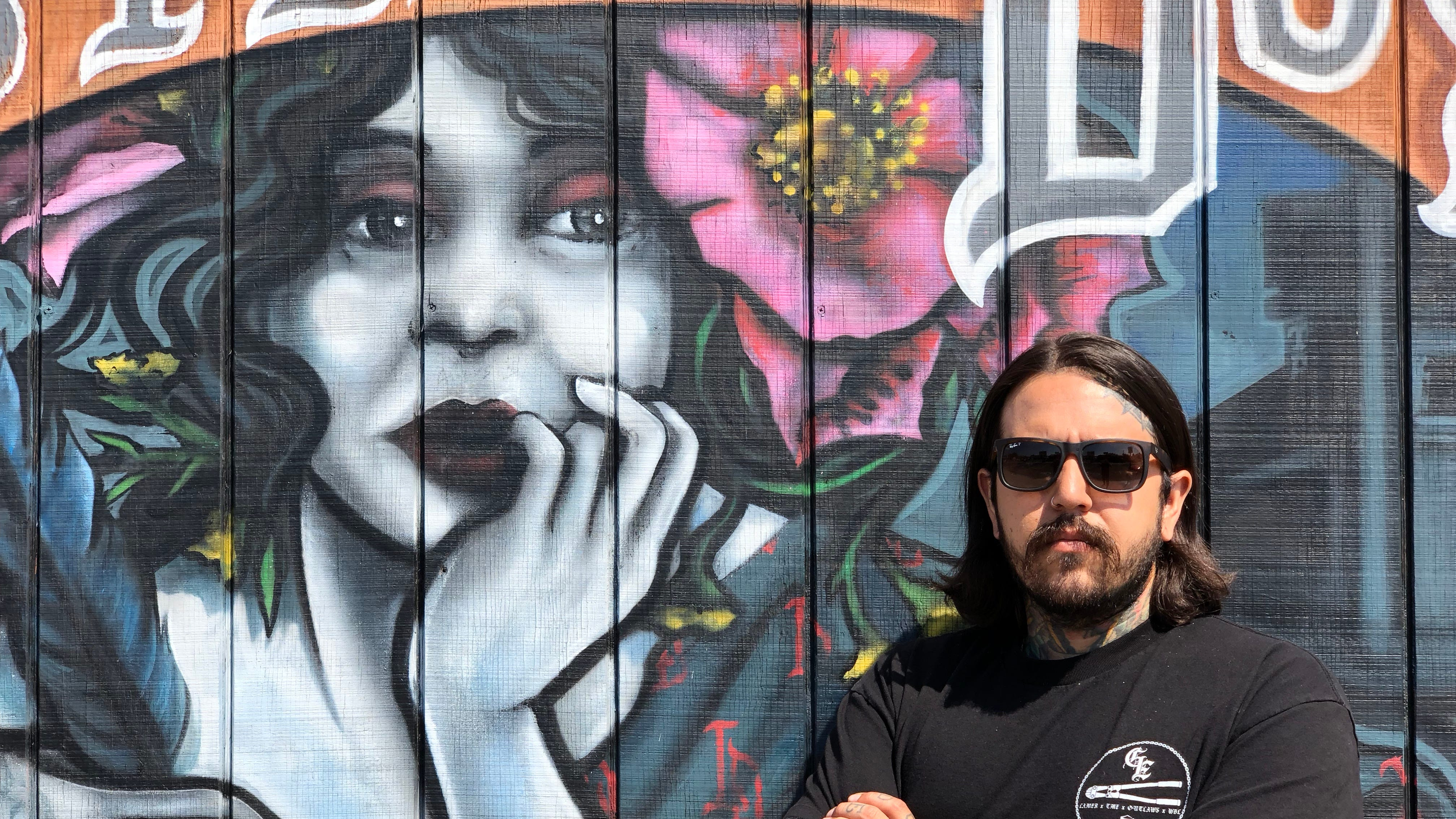 "Tony Medellin poses in front of  Lasting Dose Tattoo shop in Midtown Reno. Medellin competed on the Paramount Network's ""Ink Masters"" reality show, which will air Aug. 28, 2018."
