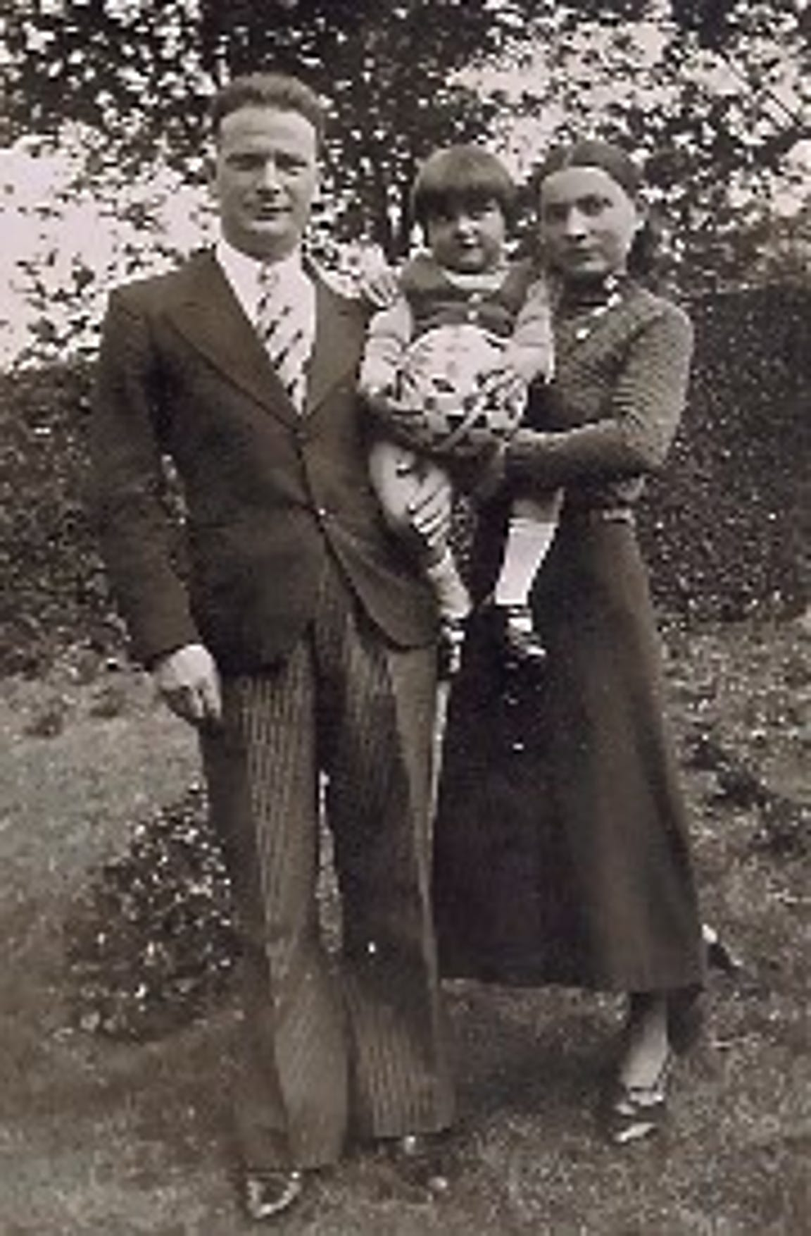 A photo of Srul and Chana Malmed holding their then young daughter, Rachel Epstein. The photo was taken in 1936.