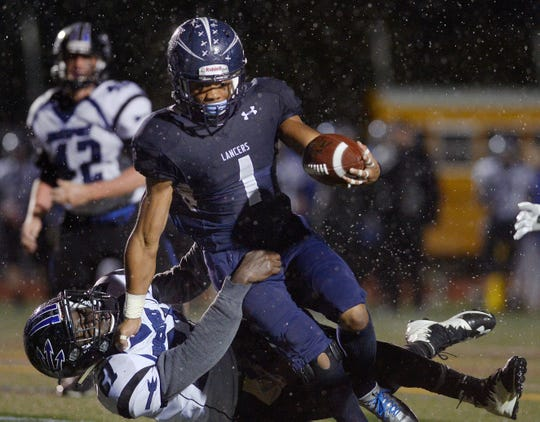 Eastridge's C.J. Turner, top, tries to break the grasp of Brockport's Shaq King during a Section V Class A quarterfinal game at Eastridge High School on Friday, Oct. 21, 2016. Turner, who now plays at the University of New Hampshire, is the older brother of Irondequoit senior Jadon Turner.