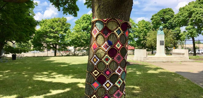 The city of Rochester objected to crocheted and knitted works such as this one being wrapped around tree trunks in downtown's Schiller Park.