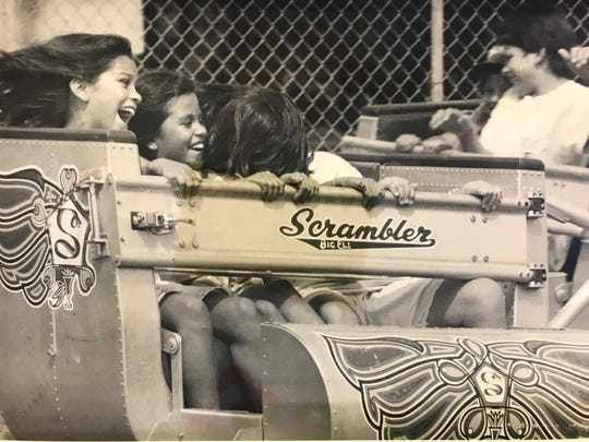Children delight as they careen around on the Scrambler at Neff's Amusement Park in San Angelo in 1991.