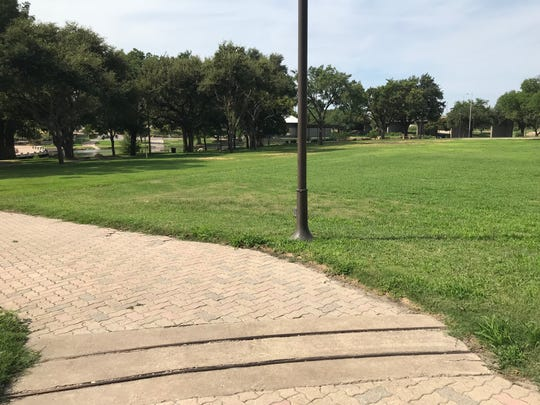 Train tracks, which were once a part of Neff's Amusement Park, cross the paved path leading down to the Concho River from the parking  area located at Neff's Way and Oakes Street in San Angelo.