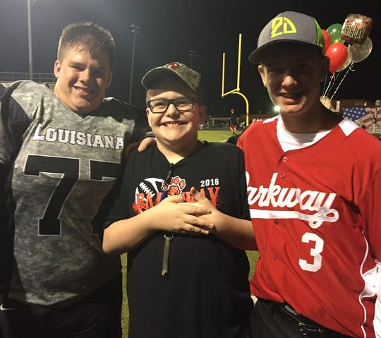The Cloinger boys, Connor, Camden and Collier have fun at athletic events.