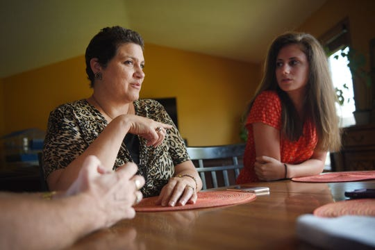 Maria Warne talks about how her daughter Olivia likes to volunteer in addition to paying attention to her studies  Wednesday, July 25, at their home in Sioux Falls.