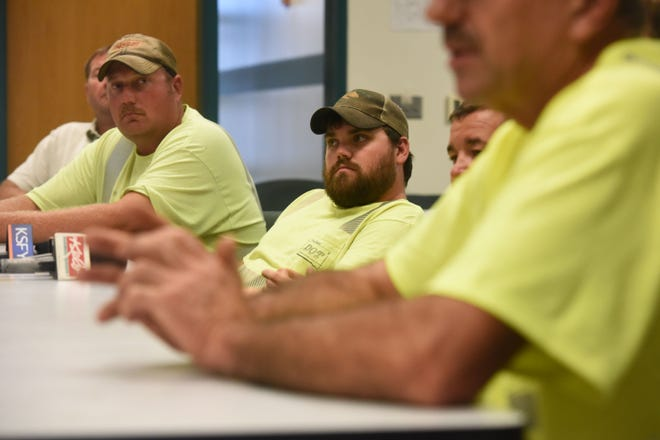 Workers who stepped in to prevent an I-90 suicide yesterday attend a press conference at the Department of Transportation office Thursday, Aug. 16, 2018.