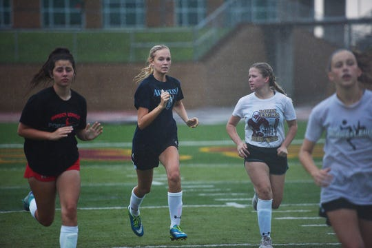 Emma Malcom practices with her team Thursday, Aug 16, at Harrisburg High School in Harrisburg.